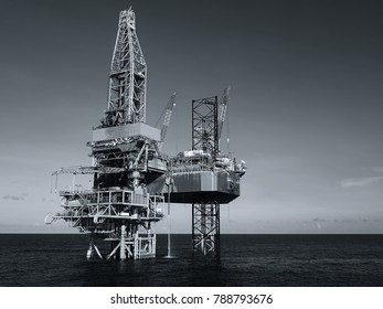 Jack up drilling rig in monochrome