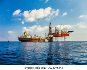 Jack up drilling rig on oil production platform and FPSO ship