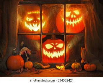 Jack and frightened pumpkins in an old window
