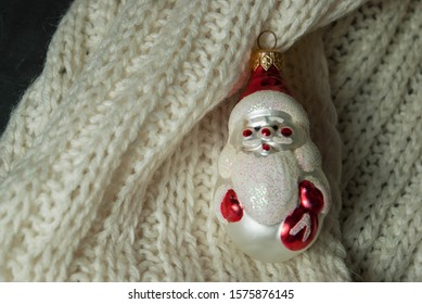 Jack Frost christmas tree toy on knitting background.
