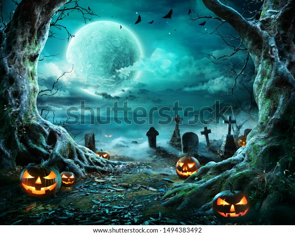 Jack 'O Lantern In Cemetery In Spooky Night With Full Moon - Halloween