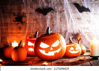 Jack O Lantern Halloween pumpkins, spiders on web , bats and burning candles