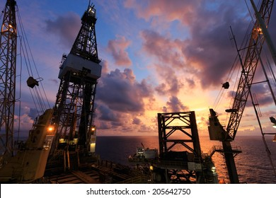 Jack Up Oil Drilling Rig At Sun Rise Time - Oil and Gas Industry