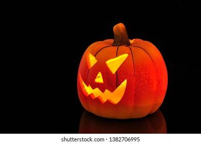 Jack o'lantern isolated on black.