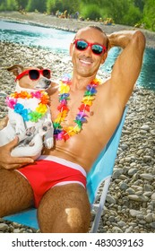 jack russell dog with owner wearing funny fancy red sunglasses, lying on hammock or beach chair lounger together as lovers or friends, on summer vacation holidays