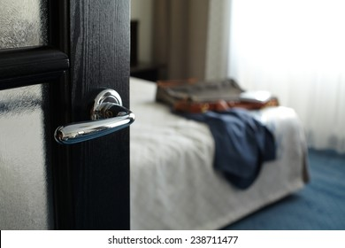 Jacket and bag and notebook on the bed in hotel room