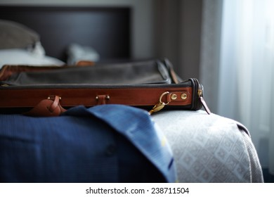 Jacket and bag on the bed in hotel room