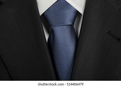 jacket with fancy blue tie