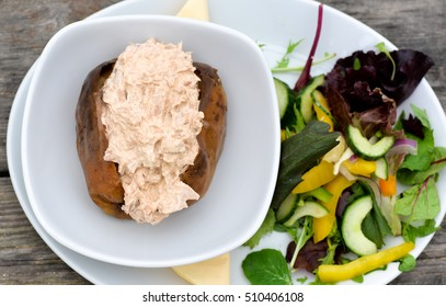 Jacket potato filled with tuna mayo, salad on the side.