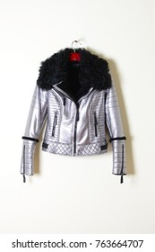 Jacket with sheepskin, silver with black collar and zipper. Outerwear. Fashionable coats collection 2017-2018. Vertical photo.