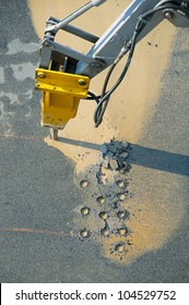 Jackhammer - pneumatic drill breaking street asphalt, repairing damaged water supply