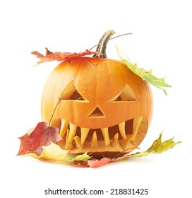 Jack-o'-lanterns orange halloween pumpkin head with the sharp teeth and scary facial expression and covered with the colorful maple leaves, isolated over the white background