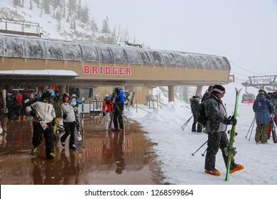 Jackson Hole Resort, Wyoming / USA December 24, 2018 Skiers at the Bridger Gondola ski lift in winter snow