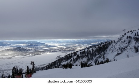 JACKSON HOLE, WY – DECEMBER 23, 2016: View from the top of the Tetons in Jackson Hole, Wyoming.  A thick layer of cloud blankets the valley at Jackson Hole ski resort.