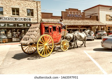JACKSON HOLE, WY - JULY 11, 2019: Colorful horse carriage with tourists in the town. Jackson is a famous tourist destination.