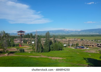 JACKSON HOLE, WYOMING - JUNE 27, 2017: Teton Village seen from the Bridger Gondola. The Gondola takes hikers and sightseers to the summit of Rendezvous Mountain for views of the valley.