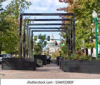 Jackson, MS / USA - October 24, 2019: Parklet on Congress Street in downtown Jackson, MS, with the state capitol in the background