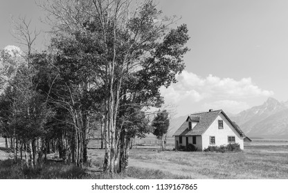 JACKSON, WYOMING - AUGUST 09, 2014:  Early Mormon homestead photographed along Mormon Row Historic district with Grand Tetons in the background  on August 09, 2014 near Jackson, Wyoming, USA.