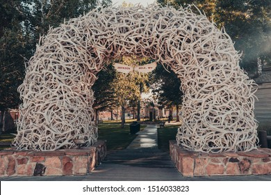 Jackson, Wyoming, USA - August 17, 2019: Elk antler arches in Jackson Town Square, Jackson Hole, Wyoming, USA. Sunlight shines through from the side.