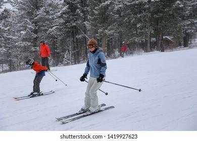 Jackson, Wyoming / USA - December 24, 2018:  People sking on groomed terrain at Jackson Hole Resort in winter snow