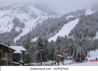 Jackson, Wyoming / USA - December 24, 2018:  Downhill ski terrain and gondola chair lifts at Jackson Hole ski resort