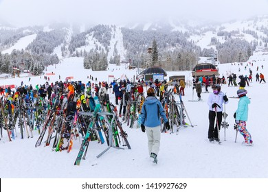 Jackson, Wyoming / USA - December 24, 2018:  Crowded ski slope with skiers and ski racks at Jackson Hole Mountain Resort in winter