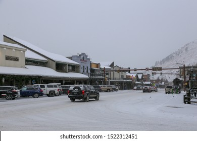 Jackson, Wyoming / USA - December 24, 2018:  Snow covered streets of small town Jackson on Christmas Eve with winter weather
