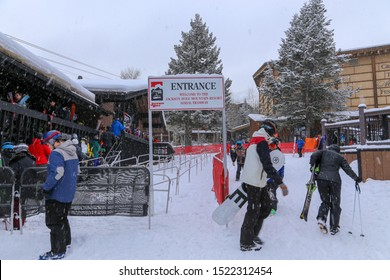 Jackson, Wyoming / USA - December 24, 2018:  Skiers and snowboarders in line for the tram at Jackson Hole Mountain Resort on a c old winter day