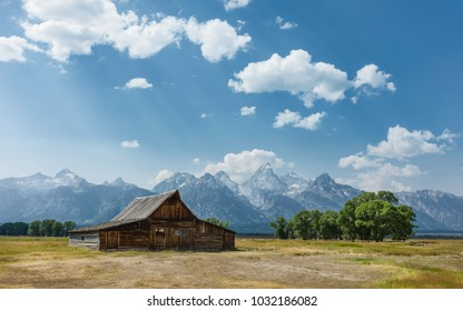 Jackson, Wyoming, USA. Early Mormon homestead set gainst the Grand Teton Mountains and in the middle of the prairie at Mormon Row, near Jackson, Wyoming, USA.