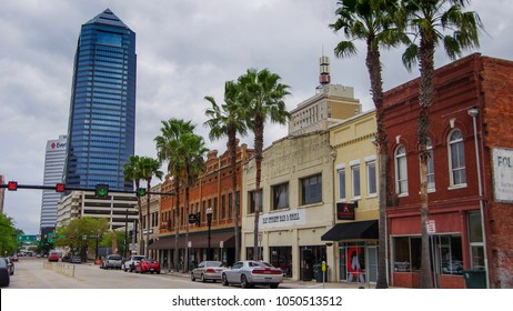 Jacksonville, FL—March 19, 2018 cars and palm trees line the street of downtown Jacksonville with a mix of modern and historic architecture