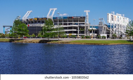 Jacksonville, FL—March 21, 2018, football stadium stands empty next to lake on sunny day