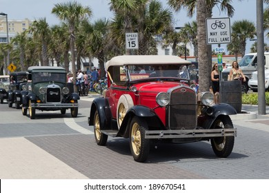 JACKSONVILLE BEACH, FL - APRIL 27, 2014: A classic red Ford car at the 68th annual Opening of the Beaches Parade. Each year the parade officially opens the beaches for the summer months.