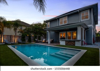 Jacksonville Beach, Florida / USA - November 9 2019: Backyard of a pool home at night