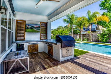 Jacksonville Beach, Florida / USA - November 9 2019: Backyard with pool and outdoor kitchen