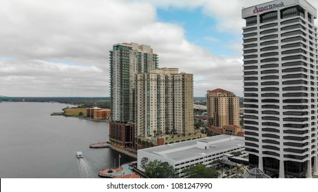 JACKSONVILLE, FL - APRIL 8, 2018: Aerial city view from the river on a cloudy day. The city is a major attraction in Florida.