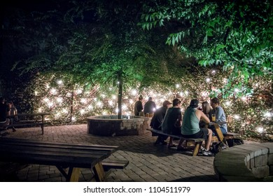 Jacksonville, FL - May 4, 2018: Tourists enjoy happy hour as they relax in Aardwolf Brewing Company's patio area May 4, 2018 in Jacksonville.
