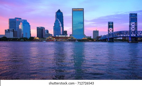 Jacksonville, Florida city skyline over the St. John's River at sunset (logos blurred for commercial use)