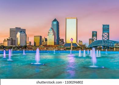 Jacksonville, Florida, USA downtown skyline and fountain at dusk.