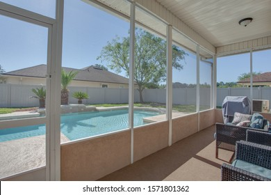 Jacksonville, Florida / USA - November 26 2019: Screened in patio with view of the pool