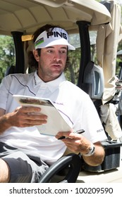JACKSONVILLE, FLORIDA-APRIL 14: Professional Golfer Bubba Watson signing autographs at the Tim Tebow Foundation Celebrity Golf Classic on April 14, 2012 in Jacksonville, Florida.