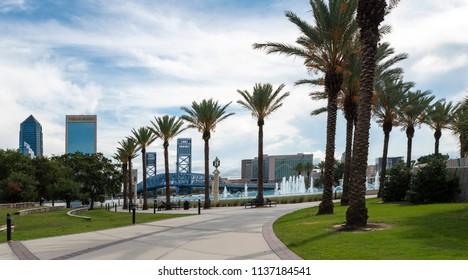 Jacksonville, FL/USA- 07/12/2018: The Jacksonville skyline is showcased across the St. John's River at Friendship Fountain park.