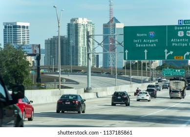 Jacksonville, FL/USA- 07/13/2018: Traffic flows towards downtown Jacksonville just after rush hour.