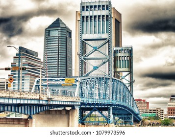Jacksonville skyline with bridge and buildings on a overcast day.