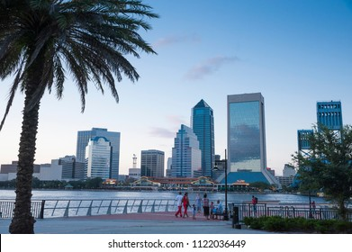 The Jacksonville skyline can be seen across the water as dusk approaches.