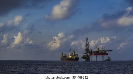 Jackup drilling rig and FPSO facility view in oil and gas offshore field