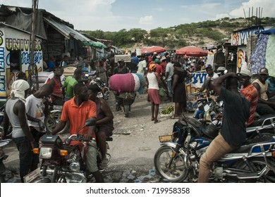 Jacmel, Haiti - Circa August 2015: Motorbike taxis are giving rides to the busy a market place near Jacmel