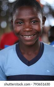 JACMEL, HAITI - June 2013: Young boy smiles in his village