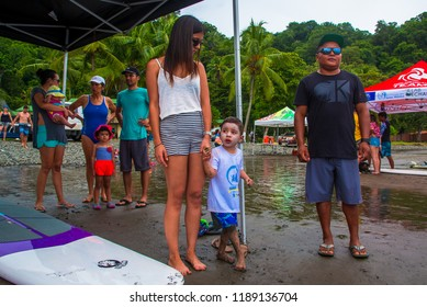 Jaco Beach, Costa Rica, September 23, 2018: Children's adapted surf camp for children with autism, cerebral palsy, muscular dystrophy, paraplegia, spina bifida, etc.
