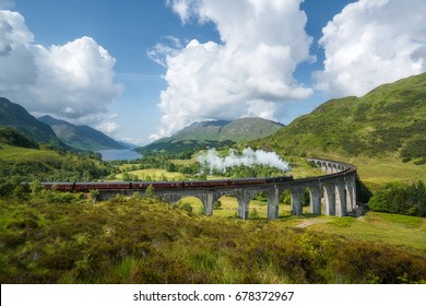 The Jacobite steam train, also known as Hogwarts Express in Harry Potter movies, passes Glenfinnan viaduct.