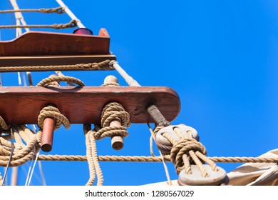 Jacobs ladder made of ropes at old sailing ship on nostalgic cruise, blue sky background (copy space)